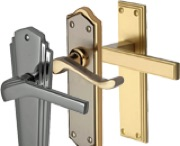Heritage Brass Door Handles On Backplate