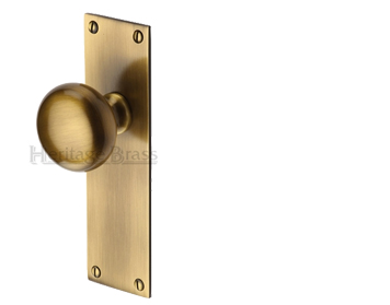 'BALMORAL' MORTICE DOOR KNOBS ON BACKPLATE, ANTIQUE BRASS - BAL-AT