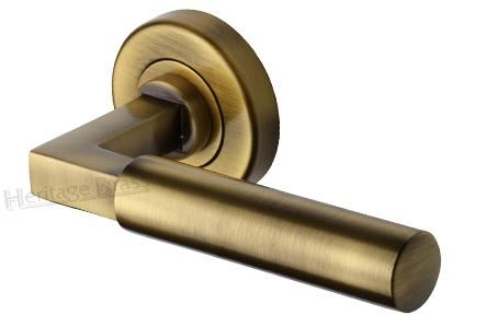 Heritage Brass 'Bauhaus' Antique Brass Door Handles On Round Rose - V2259-AT - Heritage Brass 'Bauhaus' Antique Brass Door Handles On Round Rose